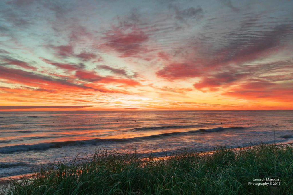 Foto eines rot-gelben Sonnenaufgangs auf PEI